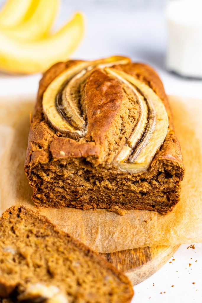 Gluten-free and dairy-free banana bread with a slice removed.