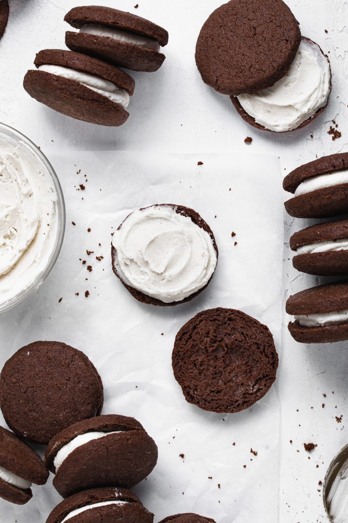 Filling gluten-free oreos with vanilla frosting.