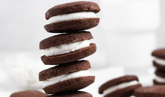 Five gluten-free oreos stacked on top of each other.