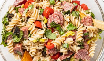 gluten-free pasta salad in a big bowl with a wooden spoon