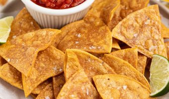 Gluten-Free baked tortilla chips with a side of salsa and beer.