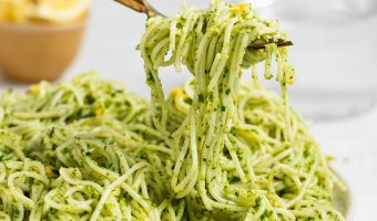 Kale pesto in spaghetti being twirled with a fork.