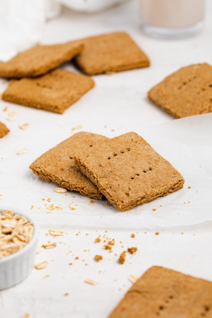 vegan graham crackers witha glass of almond milk and rolled oats