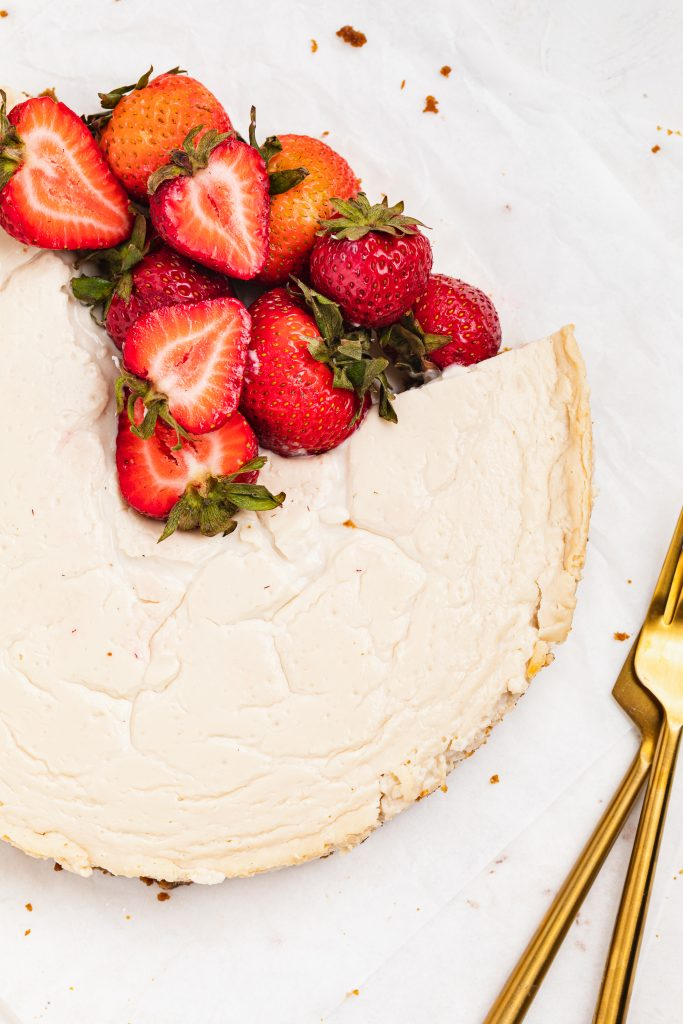 close up overhead image of healthy cheesecake with fresh strawberries of healthy cheese